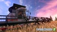 Woman farmer driving a harvester in FS 17